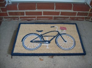 I did buy a cute mat for outside my first apartment door in Indiana.