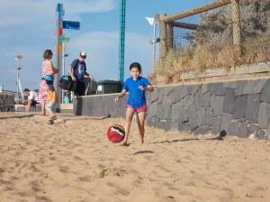 Kiana having her fun on the beach. Later we played Giants burying treasure.