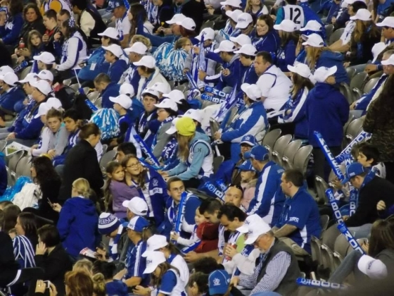 North Melbourne cheer squad, cheering the Roos to a 60+ point win over St Kilda.