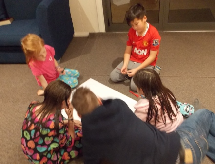 "Some of the kids with Ian, working on their own Missionary ""SIM city."""