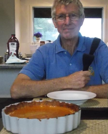 Owen ready to slice the pumpkin pie.