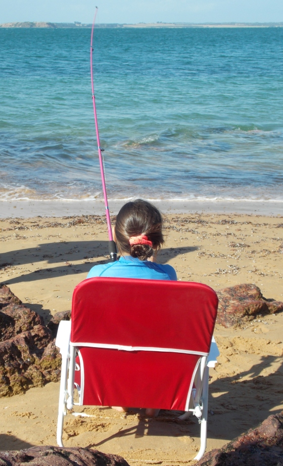 Kiana, fishing comfortably from her chair.