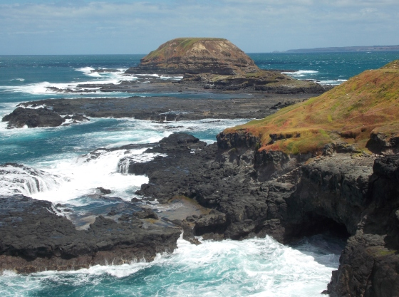 The wind and sea have carved a cave into the rock. The Nobbies, Phillip Island, Australia.